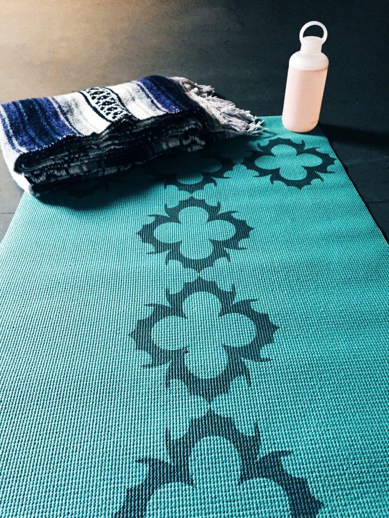 Yoga mat blanket and water bottle